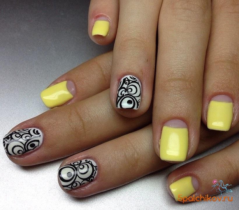 Желтые с черным ногти